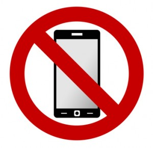 No mobile phone allowed sign.
